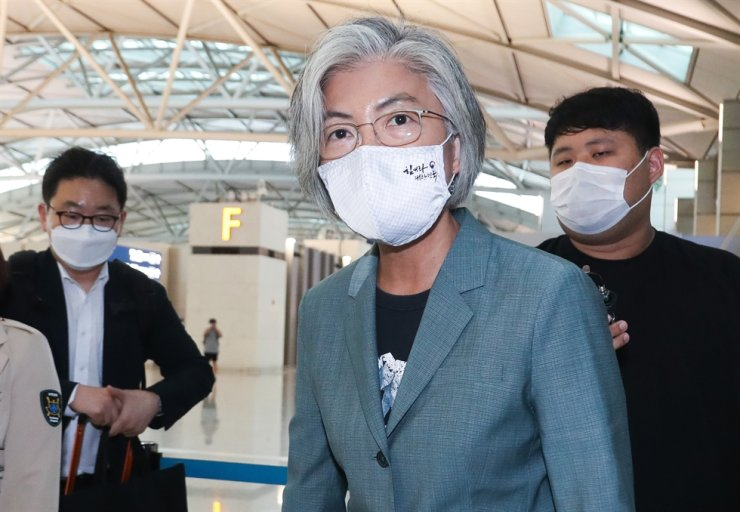 Foreign Minister Kang Kyung-wha walks through Incheon International Airport, Sunday, before leaving for Germany to have talks with German Foreign Minister Heiko Maas Monday in Berlin. This was Kang's first overseas trip in nearly six months, as overseas travel and face-to-face meetings have been put on hold due to the COVID-19 pandemic. Yonhap