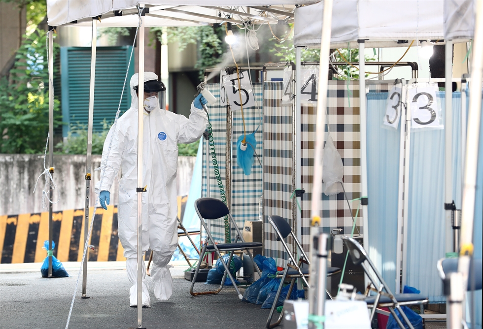 A boy takes a coronavirus test at Hwasun Elementary School, South Jeolla Province, Monday. A teacher of the school tested positive, prompting a school-wide virus test affecting nearly 1,000 teachers and students. / Yonhap