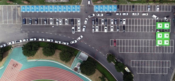 Cars wait in line at a drive-through COVID-19 testing location at a parking lot of a sports center in Hwasun, South Jeolla Province, Monday. Coronavirus infections that had been mostly in Seoul and its surrounding areas recently appear to be spreading rapidly nationwide. / Yonhap