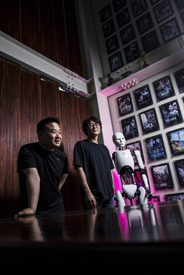 Hwang Hyo-kyun, left, and Kwak Tae-yong, heads of Technical Art Studio CELL, the country's leading special effects makeup company, pose during an interview with The Korea Times at the company in Ilsan, Gyeonggi Province on July 23. Korea Times photos by Shim Hyun-chul
