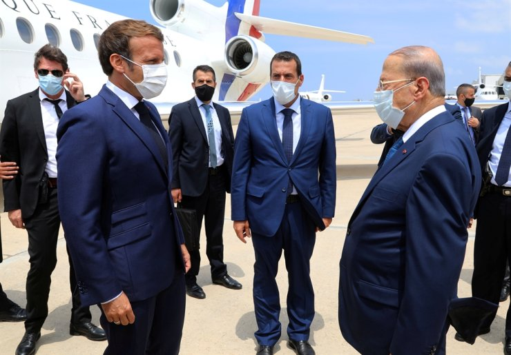 Lebanon's President Michel Aoun, right, welcomes French President Emmanuel Macron upon Macron's arrival at the airport in Beirut, Lebanon, Aug. 6. Reuters