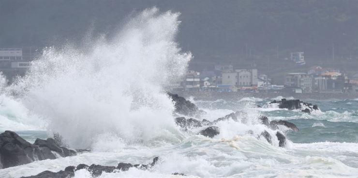 Strong winds and high waves hit the coast of Korea's southern Jeju Island, Tuesday, as Typhoon Bavi approaches. Yonhap