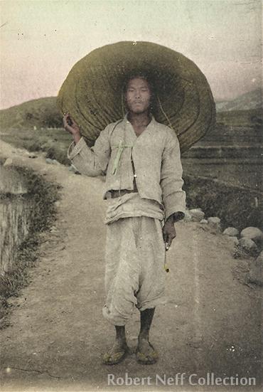 A Korean gentleman in a smoky alley, circa 1912 / Robert Neff Collection