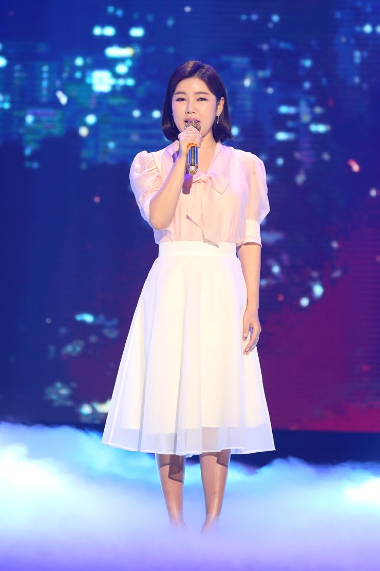 Trot singer Song Ga-in sings during a recording session. Courtesy of Seoul Metropolitan Government