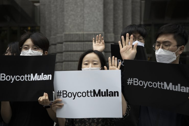Korean activists hold #BoycottMulan banner during a press conference to boycott Disney's film 'Mulan' in front of Disney Korea in Gangnam-gu, Seoul, July 1. Boycotts against the live-action remake film spreads online in Korea once again ahead of its release in cinemas on Thursday after the film's final credits thanked government entities in Xinjiang, which is accused of human rights abuses against ethnic minorities. Korea Times photo by Choi Won-suk