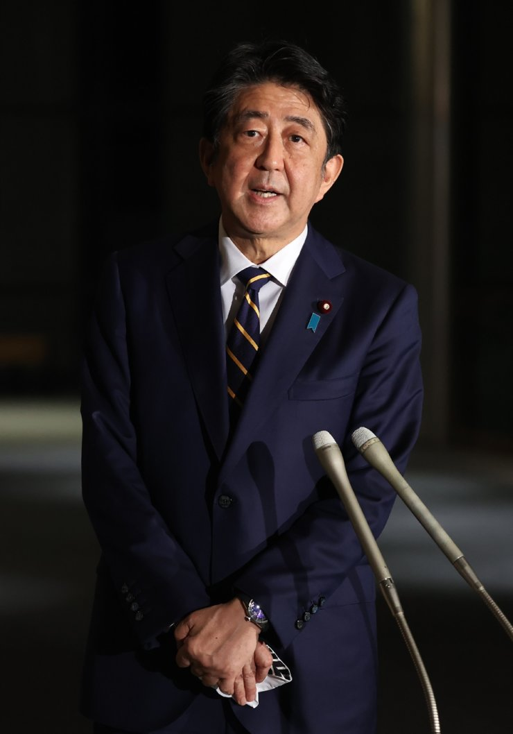 Japan's Prime Minister Shinzo Abe speaks to the media at his office in Tokyo on Friday. / AFP-Yonhap