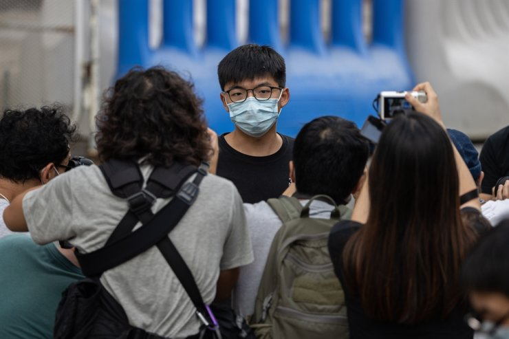 Political activist Joshua Wong walks out of the Central Police Station after being released on bail in Hong Kong, China, Sept. 24, 2020. Wong was arrested for allegedly participating in an unauthorized assembly and breaching the anti-mask law during a rally on Oct. 5 in 2019. EPA