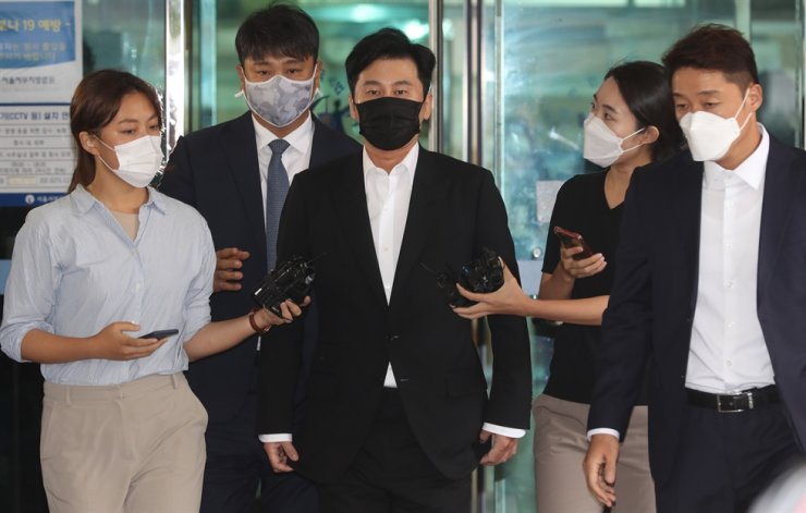 Former YG Entertainment head Yang Hyun-suk walks out of the Seoul Western District Court, Wednesday, after a hearing. Yonhap