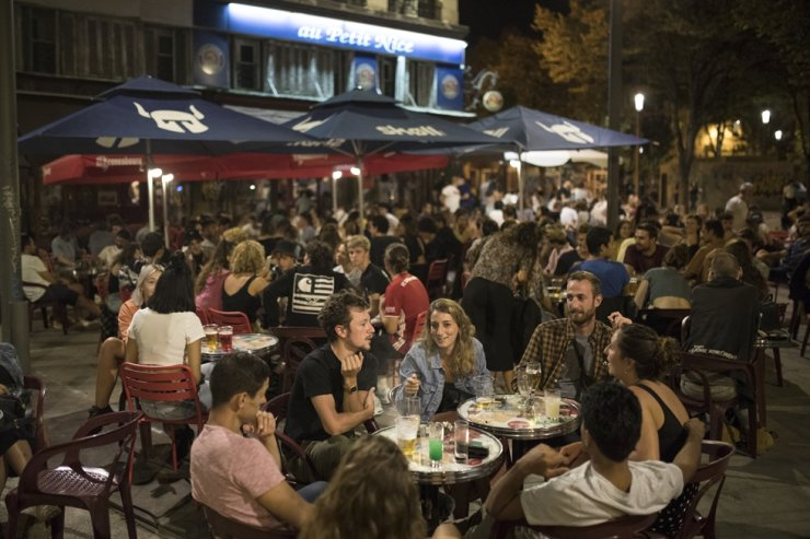 Friends have a drink together at a bar in Marseille, southern France, Saturday, Sept. 12, 2020. French Prime Minister Jean Castex warned that the virus situation is 'obviously worsening' in the country as health authorities recorded the biggest one-day jump in new cases since the pandemic began. AP