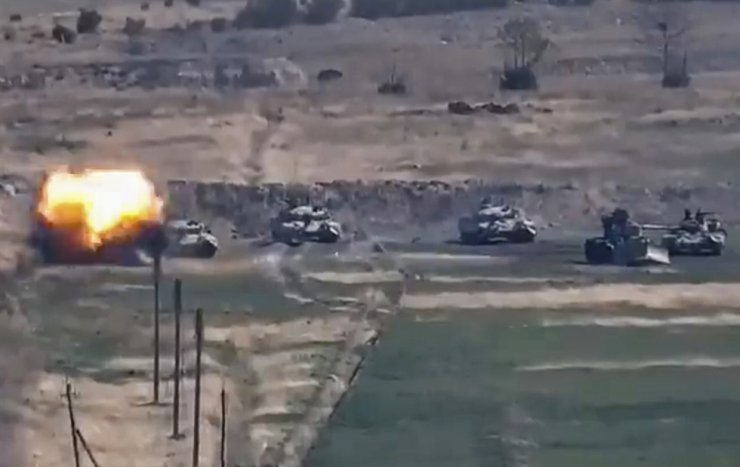 A still photo taken from handout video made available by the Ministry of Defence of the Republic of Armenia shows defeat of Azerbaijani armoured vehicles at Nagorno-Karabakh Republic, on a border of Armenia and Azerbaijan, Sept. 27, 2020. EPA