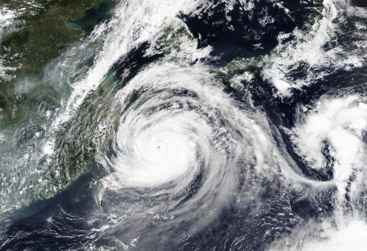 This Tuesday, Sept. 1, 2020, satellite image released by NASA shows Typhoon Maysak over Japan's southernmost islands, including Okinawa, center. The powerful typhoon was blowing over Japan's southernmost islands early Tuesday on course for Japan's main southern island and later the Korean Peninsula. /AP
