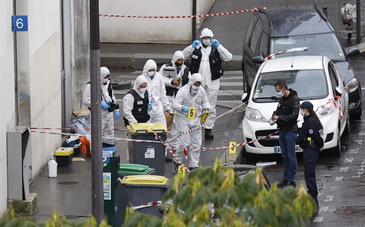 French forensic police investigators work at the site of the knife attack near the former Charlie Hebdo offices, in Paris, France, 25 September 2020, after two people have been wounded. EPA-Yonhap