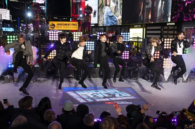 K-pop band BTS performs at the Times Square New Year's Eve celebration in New York on Dec. 31, 2019. 'Dynamite,' the group's first all-English song, debuted at No. 1 on the U.S. music charts last week, making BTS first Korean act to top the chart. The government said Monday that it will significantly increase its 2021 budget to promote the 'Korean Wave.' AP