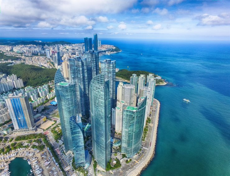 An aerial view of Busan's Marine City and Haeundae Beach / Gettyimagesbank