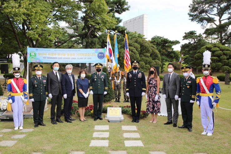 U.S. 2nd Infantry Division Commander Maj. Gen. Steve Gilland, fifth from right, Korea Defense Veterans Association (KDVA) Korea Chapter President Lee Seo-young, third from left, KDVA Korea Chapter Honorary President Kwon Oh-sung, fourth from left, and Korea Military Academy (KMA) Superintendent Lt. Gen. Chung Jin-kyung, sixth from left, pose with other guests during an unveiling ceremony of a monument at the KMA, Friday, to honor West Point graduates killed in the Korean War. Courtesy of Army