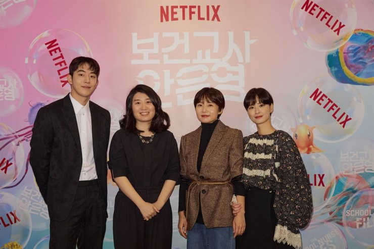 From left, actor Nam Joo-hyuk, novelist Chung Se-rang, director Lee Kyoung-mi and actor Jung Yu-mi pose during an online press event for Netflix series 'The School Nurse Files,' Thursday. Courtesy of Netflix