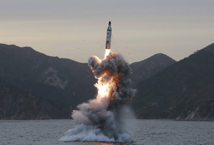 An undated file photo released by the North Korean Central News Agency, the state news agency of North Korea, shows the 'underwater test-launch of a strategic submarine ballistic missile' conducted at an undisclosed location in North Korea (reissued March 2017). Yonhap
