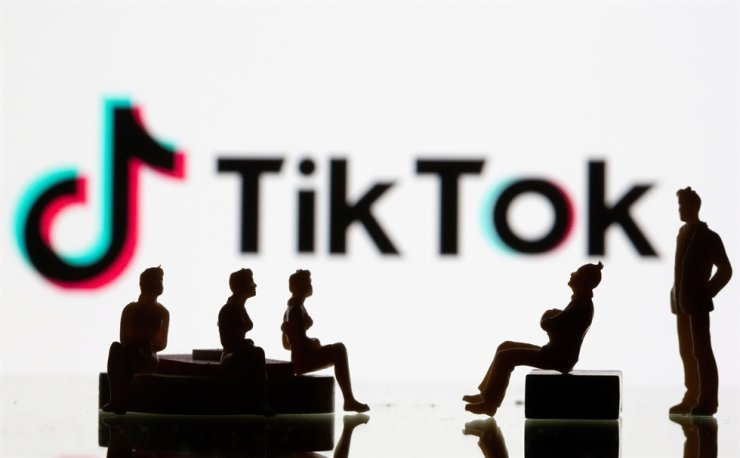 Small toy figures are seen in front of a Tiktok logo in this illustration taken, Sept. 9, 2020. Reuters