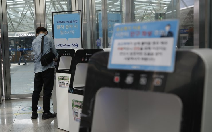 A passenger uses hand sanitizer before boarding a train at the Seoul Railway Station in Seoul, Thursday, Sept. 10, 2020. AP