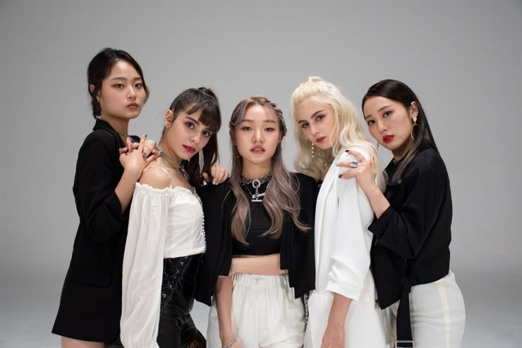 Soon-to-debut K-pop girl group PRISMA. From left, Gyeongmin, Miriam, Sally, Nia and Eunbyeol. Courtesy of UnionWave Entertainment