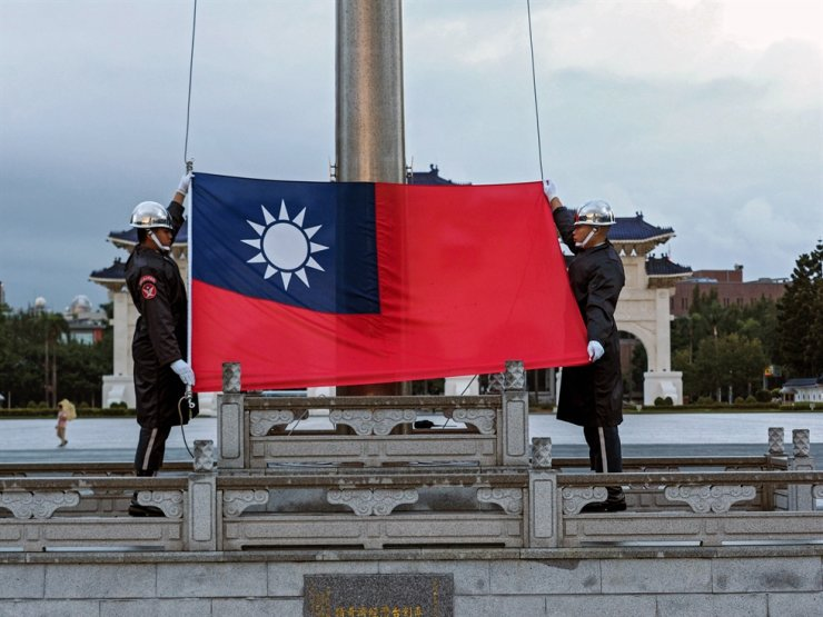Soldiers perform flag-raising ceremony in Taipei, Taiwan, Sept. 20, 2020. On Sept. 20, President Tsai denounced nearly 40 Chinese military aircrafts intruding Taiwan's Air Defence Identification Zone in the past two days, calling it a threat to the entire region. EPA