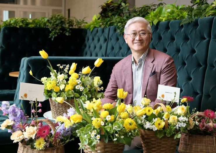 AmorePacific Chairman Suh Kyung-bae poses in the photo when he participated in the 'Flower Bucket Challenge' campaign on April 24. / Courtesy of AmorePacific