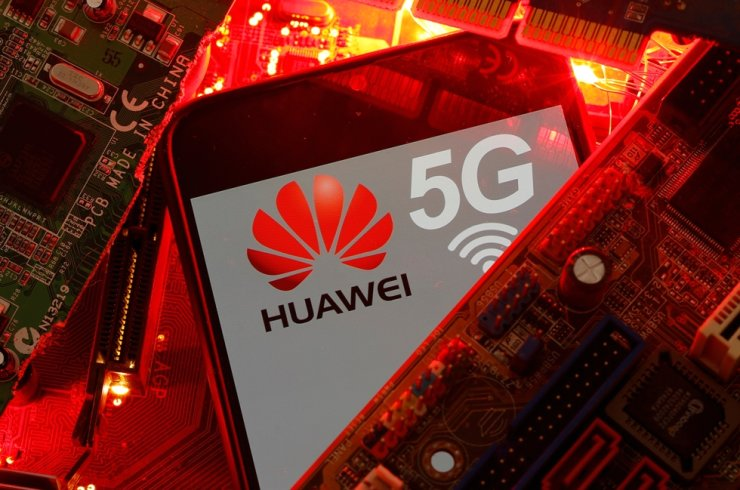 A smartphone with Huawei and 5G network logos is seen on a PC motherboard in this illustration from Jan. 29. Reuters-Yonhap