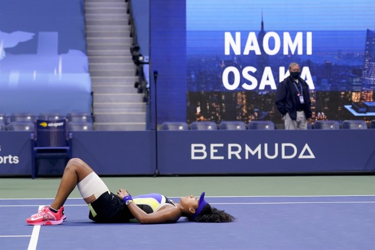 Naomi Osaka, of Japan, reacts after defeating Victoria Azarenka, of Belarus, in the women's singles final of the US Open tennis championships, Saturday, Sept. 12, 2020, in New York. AP
