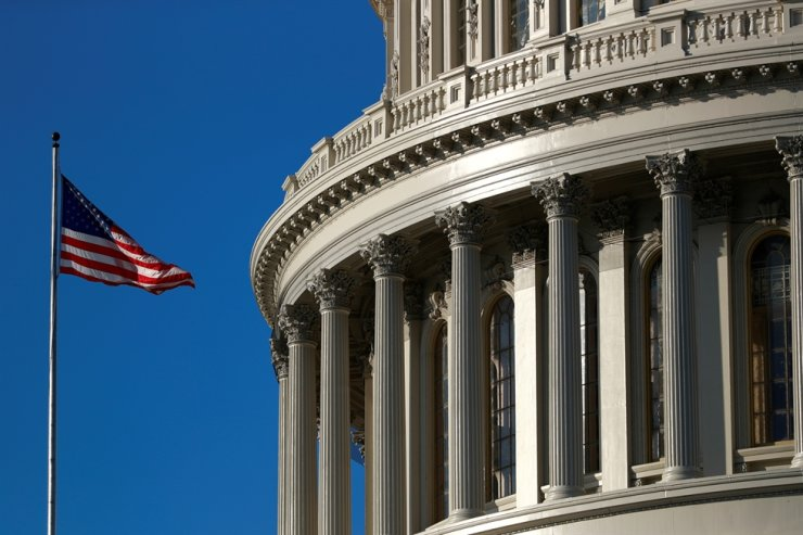 An American flag flies outside the U.S. Capitol dome in Washington, D.C. Reuters