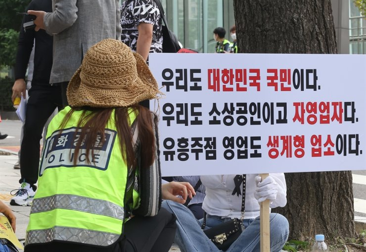 An owner of an 'adult entertainment facility' holds a picket demanding the second emergency relief fund given to small- and medium-sized enterprises in front of the National Assembly in Yeouido, Seoul, Sept. 11. Korea Times file