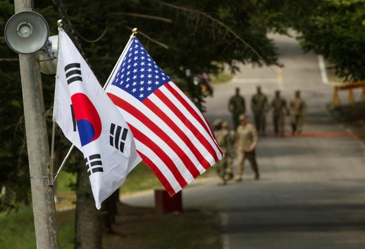 In this Aug. 23, 2016, file photo, the South Korean and American flags fly next to each other at Yongin, Gyeonggi Province. The United States on Thursday expressed its support for South Korea in condemning North Korea for the killing of a South Korean government official. Reuters