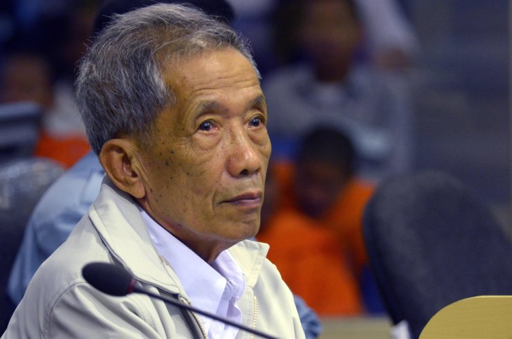 This file handout photo taken on Feb. 3, 2012, and released by the Extraordinary Chamber in the Courts of Cambodia (ECCC) shows former Khmer Rouge prison chief Kaing Guek Eav, better known as Duch, sitting in the courtroom at the ECCC in Phnom Penh. The former chief interrogator and torturer for Cambodia's genocidal Khmer Rouge regime died early on Sept. 2, 2020, in hospital in Phnom Penh. AFP
