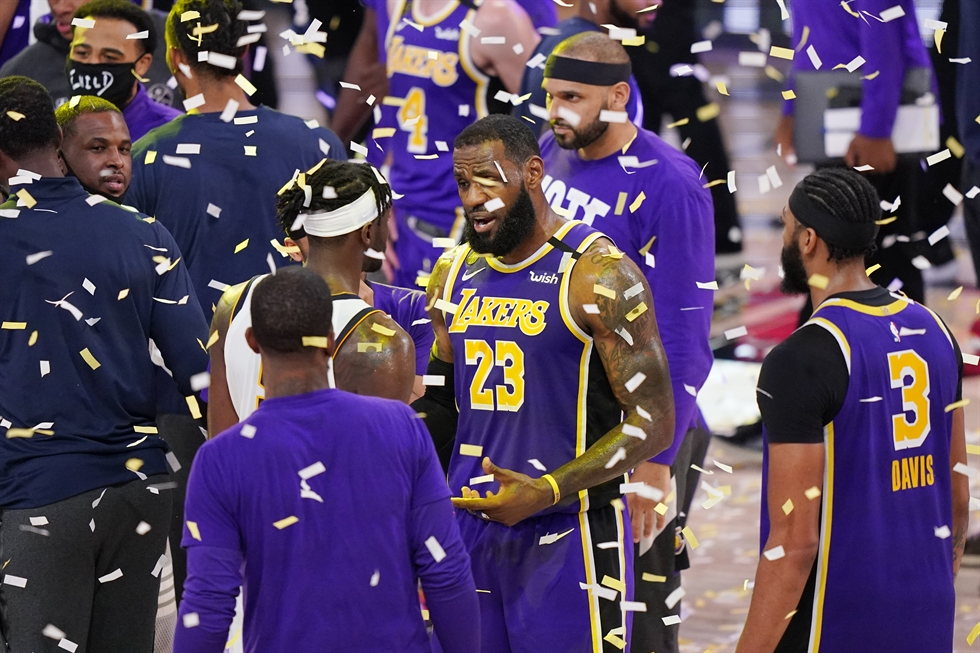 The Los Angeles Lakers celebrate after beating the Denver Nuggets in an NBA conference final playoff basketball game Saturday, Sept. 26, 2020, in Lake Buena Vista, Fla. AP