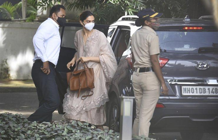 Bollywood actor, Deepika Padukone, center, arrives at the office of narcotics control board, in Mumbai, India, Saturday, Sept. 26, 2020. AP