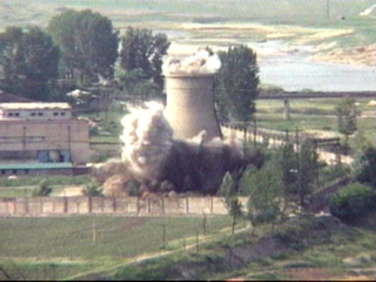 In this June 27, 2008 file image from television, the 60-foot-tall cooling tower at its main reactor complex in Yongbyon North Korea is demolished. AP