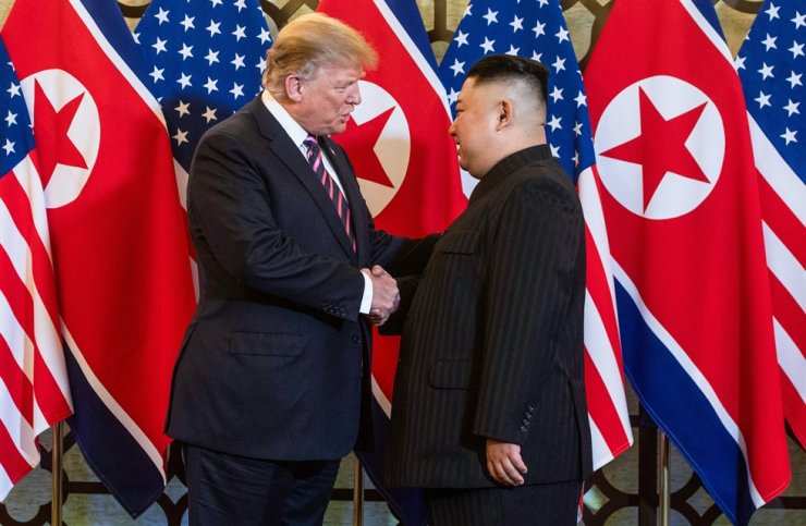 This file photo taken on Feb. 27, 2019, shows U.S. President Donald Trump shaking hands with North Korea's leader Kim Jong-un before a meeting at the Sofitel Legend Metropole hotel in Hanoi. AFP
