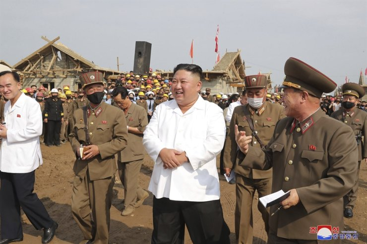 In this undated photo provided Saturday, Sept. 12, 2020, North Korean leader Kim Jong-un inspects a construction site in Taechong-ri, North Korea, in a recovery effort from recent flood and typhoon damage. Korean Central News Agency/Korea News Service via AP