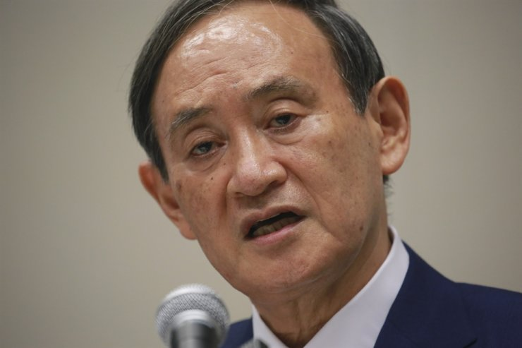 In this Sept. 2, 2020, file photo, Japan's Chief Cabinet Secretary Yoshihide Suga speaks during a news conference in Tokyo. AP