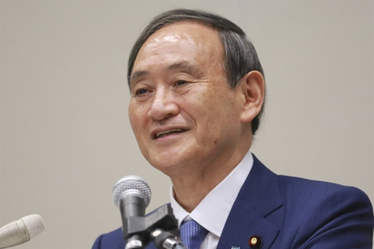 Japan's Chief Cabinet Secretary Yoshihide Suga speaks during a news conference in Tokyo, Wednesday, Sept. 2, 2020. Suga, a longtime loyal assistant and the public face of outgoing Prime Minister Shinzo Abe in daily media briefings, has emerged as a favorite to succeed him in an upcoming internal party vote. AP