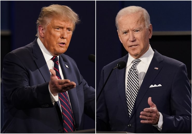 This combination of Sept. 29, 2020, file photos shows U.S. President Donald Trump, left, and former Vice President Joe Biden during the first presidential debate at Case Western University and Cleveland Clinic in Cleveland, Ohio. AP
