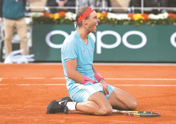 Rafael Nadal of Spain celebrates after winning the men's singles final match against Novak Djokovic of Serbia at the French Open tennis tournament 2020 at Roland Garros in Paris, France, Sunday. / Xinhua-Yonhap