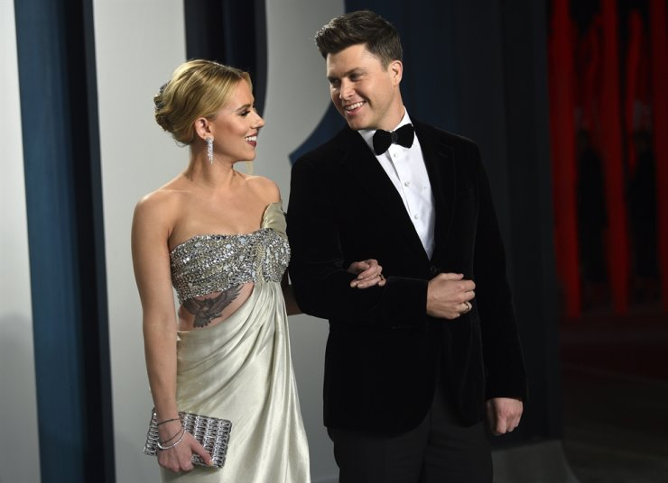 In this Feb. 9, 2020 file photo, Scarlett Johansson, left, and Colin Jost arrive at the Vanity Fair Oscar Party in Beverly Hills, Calif. AP