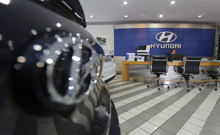 In this Jan. 25, 2018, file photo, an employee of Hyundai Motor waits for customers at the company's showroom in Seoul. AP