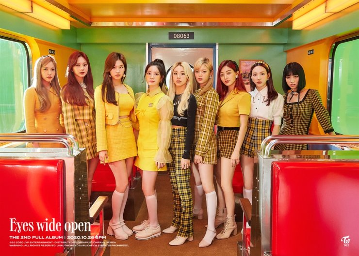 A teaser photo of K-pop girl group TWICE's new album 'Eyes wide open.' It will be released on Oct. 26. Courtesy of JYP Entertainment