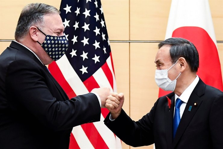 Japan's Prime Minister Yoshihide Suga and U.S. Secretary of State Mike Pompeo greet prior to their meeting at the prime minister's office in Tokyo, Oct. 6, 2020. Reuters