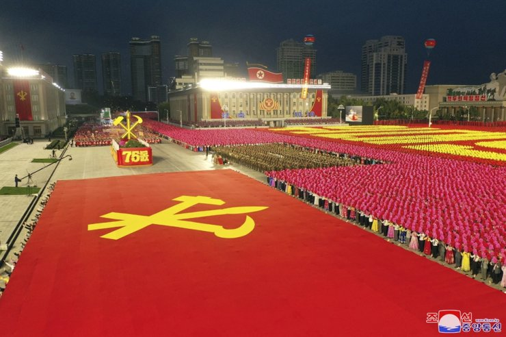 North Koreans celebrate the 75th founding anniversary of the country's ruling Workers' Party at Kim Il-sung Square in Pyongyang, Saturday. AP-Yonhap