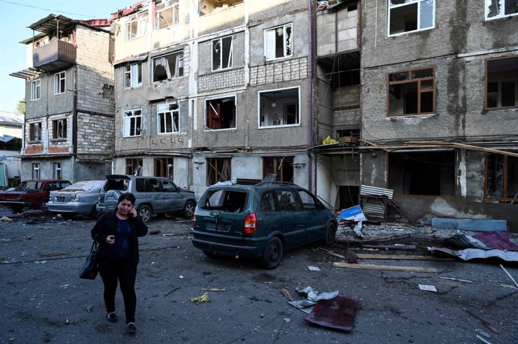 A woman cries walking in front of an apartment building that was supposedly damaged by recent shelling in the breakaway Nagorno-Karabakh region's main city of Stepanakert on Oct. 3, 2020, during the ongoing fighting between Armenia and Azerbaijan. AFP