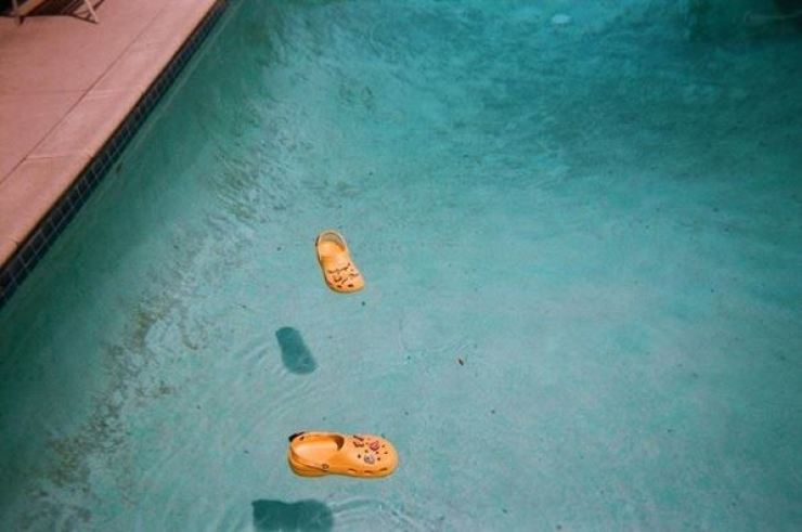 A pair of Crocs is seen afloat in a swimming pool from Justin Bieber's recent Instagram post. Instagram