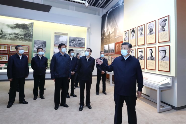 Xi Jinping and other Communist Party of China and state leaders visit an exhibition commemorating the 70th anniversary of the Chinese participation in the Korean War, Oct. 19, 2020. Xinhua-Yonhap