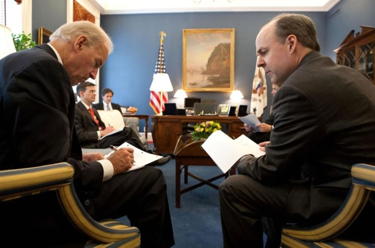 U.S. Democratic presidential nominee Joe Biden, left, is seen holding a meeting with his campaign officials, including his foreign policy adviser Brian McKeon (right), in this undated photo provided by his election campaign. Yonhap